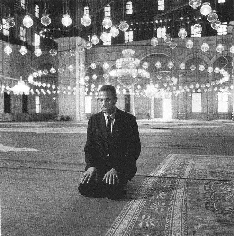 Malcolm X praying in the Mohammed Ali Mosque, Cairo, Egypt, September 1964